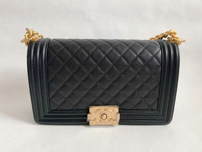 Chanel Boy Medium 10 in Black Caviar and gold hardware.
